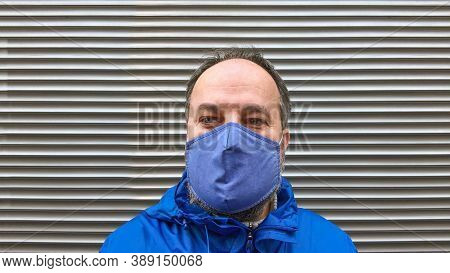 Middle Aged Man Wearing Cloth Face Mask Or Community Mask Or Everyday Mask During Corona Covid-19 Pa