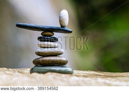 Balanced Zen stones pebbles at the waterfalls