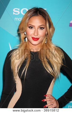 LOS ANGELES - NOV 5:  Adrienne Bailon arrives at the X-Factor Season Two FInalist Party at SLS Hotel at Beverly Hills on November 5, 2012 in Los Angeles, CA