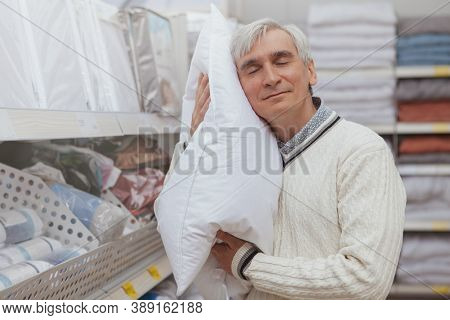 Senior Happy Man Smiling Woth His Eyes Closed, Trying Comfortable Pillow At Furniture Store, Copy Sp