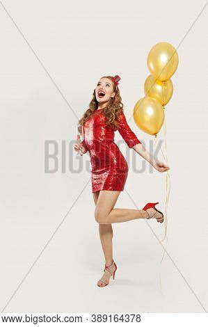 Happy Surprised Woman With Yellow Balloons Standing On White Background, Christmas Or New Year Party