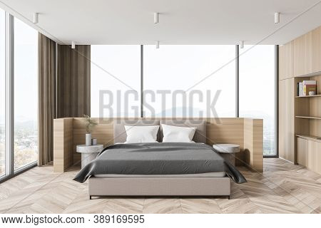 Interior Of Stylish Panoramic Master Bedroom With Wooden Walls And Floor And Comfortable King Size B