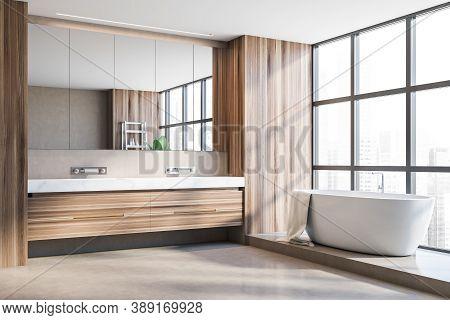 Corner Of Stylish Panoramic Bathroom With Wooden Walls, Concrete Floor, Comfortable Bathtub And Doub
