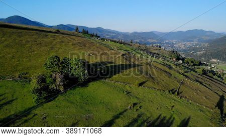 Topview Of Green Meadows In Mountains. Scenery Of Rural Village.