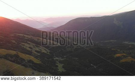 Topview Of Green Hills. Foggy Morning In The Mountains.
