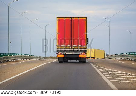 Wagons Move In The Evening On A Country Highway