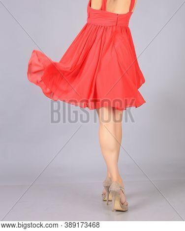 Girl In Beautiful Red Dress In Studio