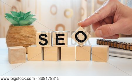 Seo Search Engine Optimization Concept. Wooden Cubes With The Abbreviation Seo