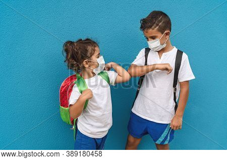 Children Wearing Face Protective Mask Going Back To School During Corona Virus Pandemic - Little Kid