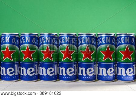 Varna, Bulgaria, October 09, 2020. Row Of Heineken 0.0 Beer Cans With Red Star On A White Wood Table