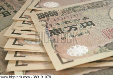 A Field Of 10000 Yen Japanese Notes. Background Or Wallpaper With Reduced Contrast And Color Saturat