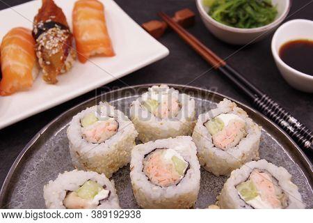 Japanese Cuisine: Sushi Rolls, Salmon Nigiri, Unagi Nigiri, Shrimp Nigiri. Ginger, Soy Sauce, Seawee