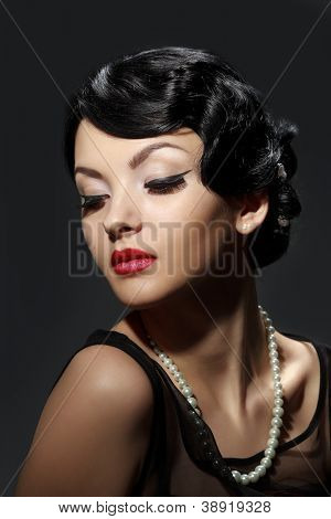 Retro portrait of sexy caucasian young woman model with red lips make-up, eye arrow makeup, purity complexion.