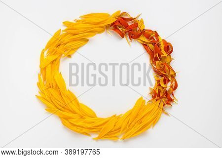 Wreath From Yellow And Red Flowers Petals.
