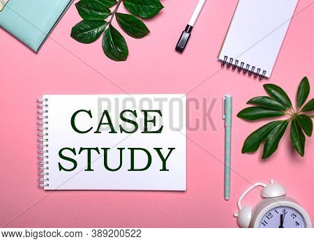 Case Study Is Written In Green On A White Notepad On A Pink Background Surrounded By Notepads, Pens,