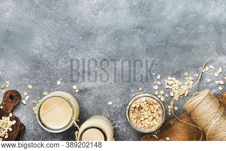 Vegan Oat Flakes Milk, Non Dairy Alternative Milk In Glass, Top View, Copy Space