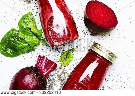 Delicious Beetroot Smoothies In Glass Bottles With Chia On White Food Background, Top View