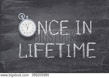 Once In Lifetime Phrase Handwritten On Chalkboard With Vintage Precise Stopwatch Used Instead Of O