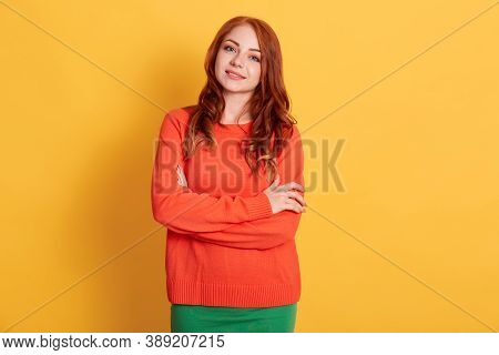 Portrait Of Young Woman Of Caucasian Appearance Wearing Casual Attire, Posing At Blank Wall With Arm