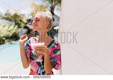 Cheerful Young Woman With Blonde Hair Looking Away With Smile. Outdoor Photo Of Spectacular Fair-hai