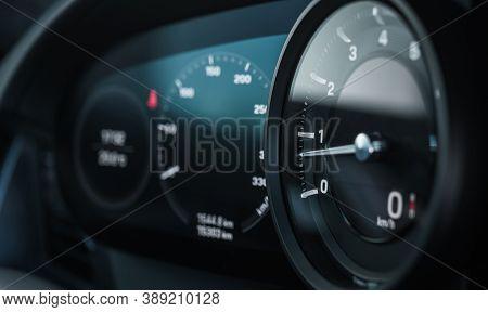 Rev Counter Tachometer Instrument In Modern Car Dashboard. Revolution-counter Measuring Device. Auto