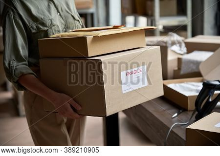 Female Distribution Warehouse Worker Or Seller Holding Ecommerce Shipping Order Boxes Preparing For