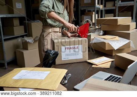 Female Post Mail Storage Worker Holding Tape Dispenser Sealing Shipping Online Store Order Courier D