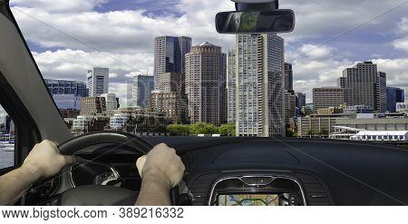 Driving A Car Towards The Scenic Skyline Of Boston, Massachusetts, Usa