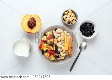Oatmeal Porridge Bowl With Peach, Raisins And Cashew Nuts. Healthy Breakfast Food, Clean Eating, Die