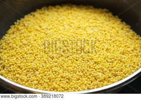 Washed Millet Groats In A Sieve, Ingredient For Making A Gluten-free Vegan Or Vegetarian Dish, Close