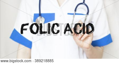 Doctor Writing Text Folic Acid With Marker, Medical Concept