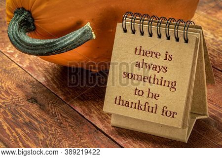 There is always something to be grateful for - a pumpkin with a handwriting in a spiral sketchbook, Thanksgiving holiday concept