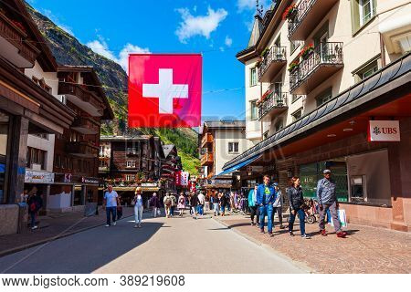 Zermatt, Switzerland - July 15, 2019: Traditional Local Houses In The Centre Of Zermatt Town In The
