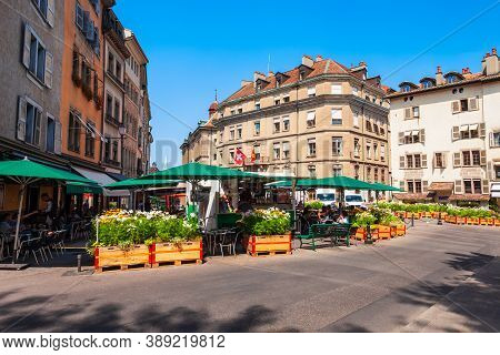 Geneva, Switzerland - July 17, 2019: Place Du Bourg-de-four Is The Main City Square In The Old Town
