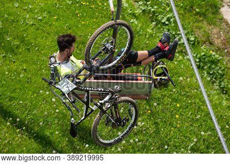Bukovel, Ukraine - May 27, 2018: Man With Bike On The Ski Lift. Ski Lift In Summer.