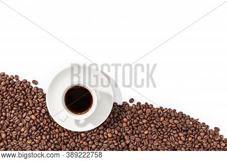 Cup Of Espresso Coffee And Roasted Beans On White Background. Coffee Wallpaper. Copy Space. Top View