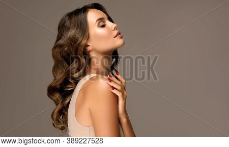 Beautiful Woman In Profile  With Long  And   Shiny Wavy  Hair .  Beauty  Model Girl With Curly Hairs