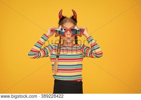 Crazy Is Her Name. Crazy Halloween Child Yellow Background. Party Girl With Crazy Look. Fashion Kid