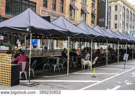 New York / Usa - October 10 2020: An Outdoor Restaurant In Midtown Manhattan. Covid Outdoor Dining