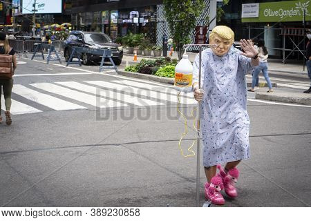 New York / Usa - October 10 2020: A Person With A Rubber Mask Of American President Donald Trump And