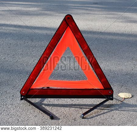 Emergency Stop Sign On The Background Of The Road. Concept Of Roadside Assistance, Travel Incidents,