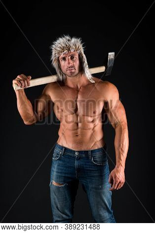 Strong Man With Muscular Six Pack Ab Muscle Torso Hold Heavy Hammer Black Background, Masculine.