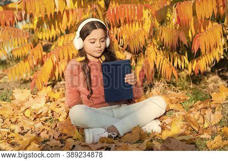 Schoolgirl Study. Child Enjoy Reading. Visual And Audio Information. Little Child Enjoy Learning At