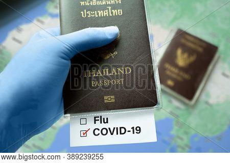 Thailand Passport, Risk-free Certificate Concept. Hand In Blue Medical Gloves Holds Thailand Passpor