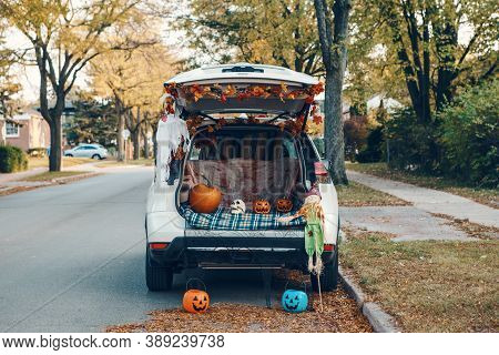 Trick O Trunk. White Car Trunk Decorated For Halloween. Autumn Fall Decor With Red Pumpkins And Yell