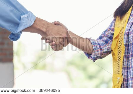 Civil Construction Engineer Teams Shaking Hands Together Wear Work Helmets Worker On Construction Si