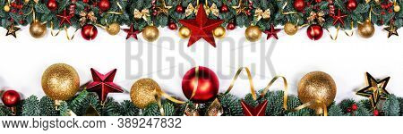 Christmas border frame design copmosition of noble fir tree branch and red golden decorations baubles isolated on white background