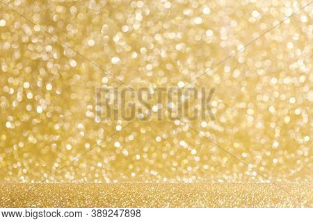 Shiny golden bokeh glitter lights abstract background, Christmas New Year party celebration concept