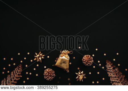 Various Festive Items And Decorations In Gold Color On A Dark Or Black Background. Top Space For Tex