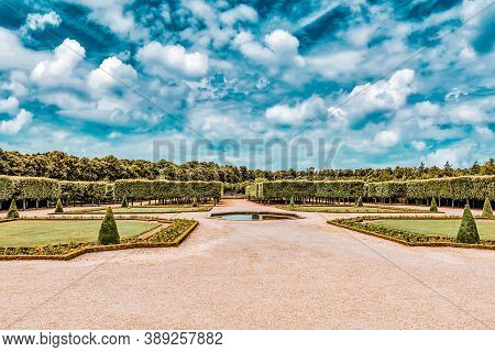 "Versailles, France - July 02, 2016 : Grand Trianon Gardens Is Famous French-style Gardens ""filled Wi"